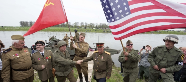 United States and Russian troops meet at the Elbe River in WWII